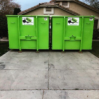 Two Dumpsters On Driveway - Bin There Dump That